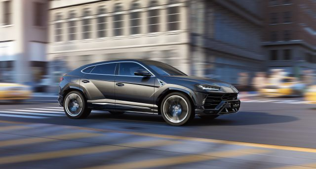 Lamborghini Urus in Black Driving Down Street