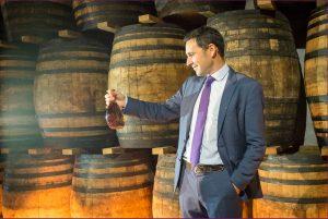 Master Distiller Benoit de Sutter holding a bottle of Courvoisier L'Essence. Photo courtesy of Coyne PR.