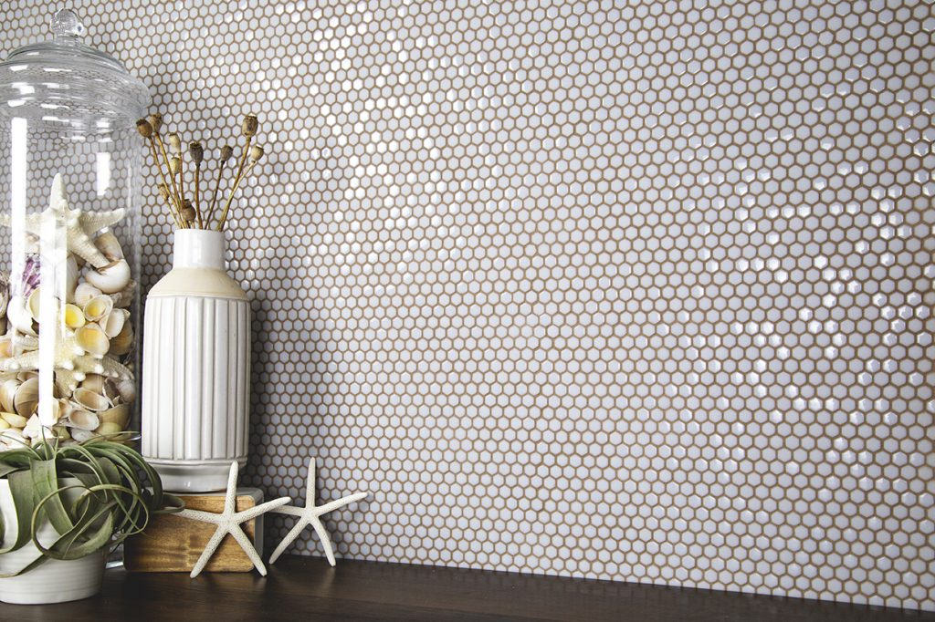 Fusion collection of tiles from Nemo Tile & Stone in colored grout.