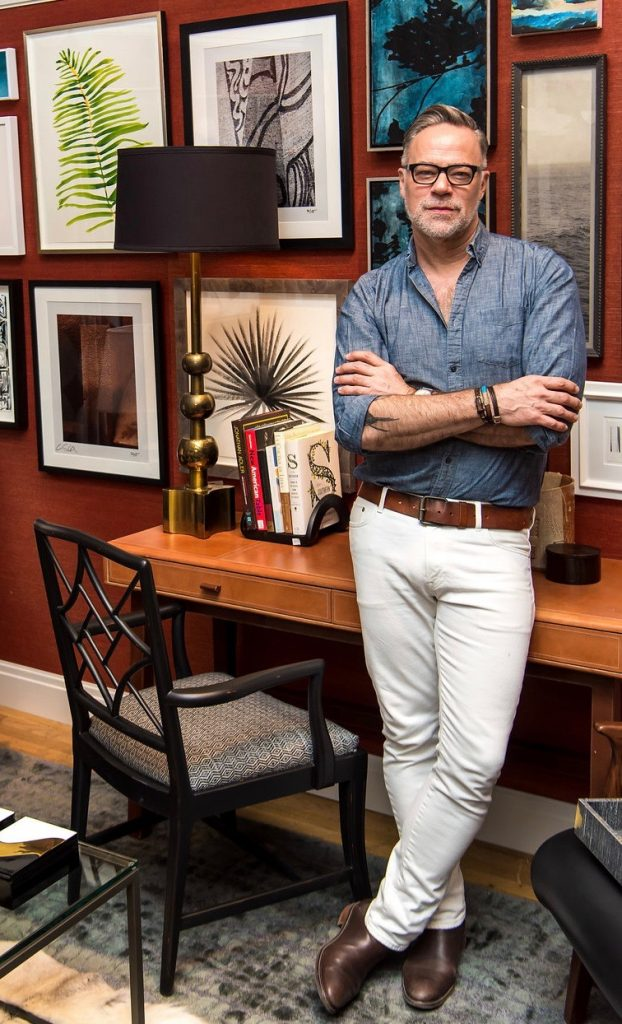 Interior designer Ron Marvin posing in front of his Design on a Dime Vignette, 2018.