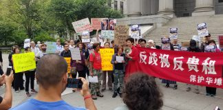 Members of the Chinatown Working Group gather for a press conference in support of the Lower East Side Organized Neighbors (LESON).