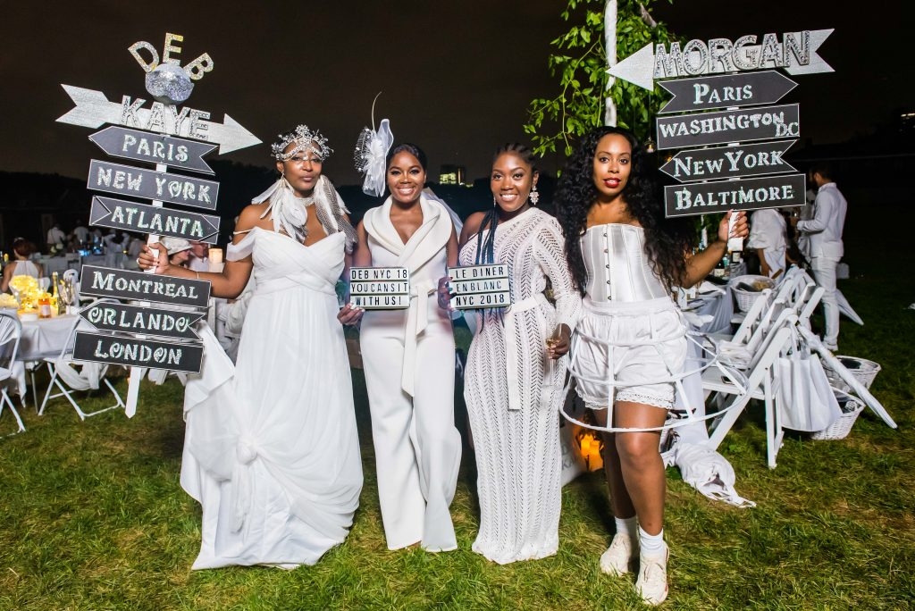 NYC attendees pose in white dresses at La Dîner en Blanc.