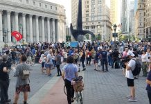 A crowd gathers at Foley Square